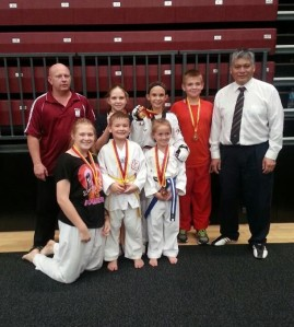 Mr Kevin Donaldson and Master Michael Tan with high performing Tans Taekwondo Ipswich students - (front) Ashley, William, Abigail, (back) Lindsey, Tamzin and Ryan.
